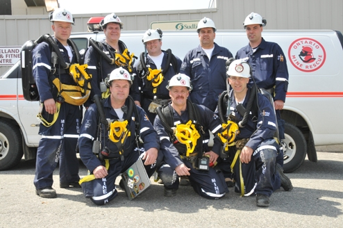 Fraser/Thayer-Lindsley Mine Rescue Team - Front Row (left to right): Dave Lachance (Captain), Luc Lalonde and Pierre Coderre (Vice-Captain) Back row (left to right): Joe Hinrich, Cliff Poirier, Greg Nadeau, Terry Dubois (Briefing Officer) and Dale Kinnonen