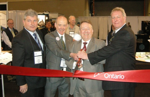 z-(L to R) Chris Hodgson, President of Ontario Mining Association; Jon Baird, PDAC President; Honourable Michael Gravelle, Minister of Northern Development, Mines and Forestry; Garry Clark, Executive Director of the Ontario Prospectors Association