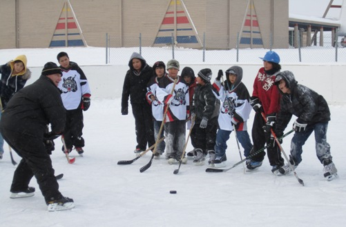 Todd Hlushko with Webequie youth during Noront hockey clinic - photo by Kaitlyn Ferris