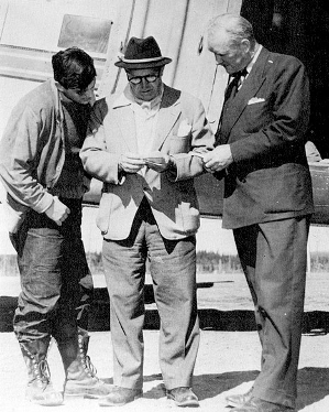 (L to R) Bobby Timmin, Jules Timmins and Iron Ore Company of Canada General Manager William Durrell